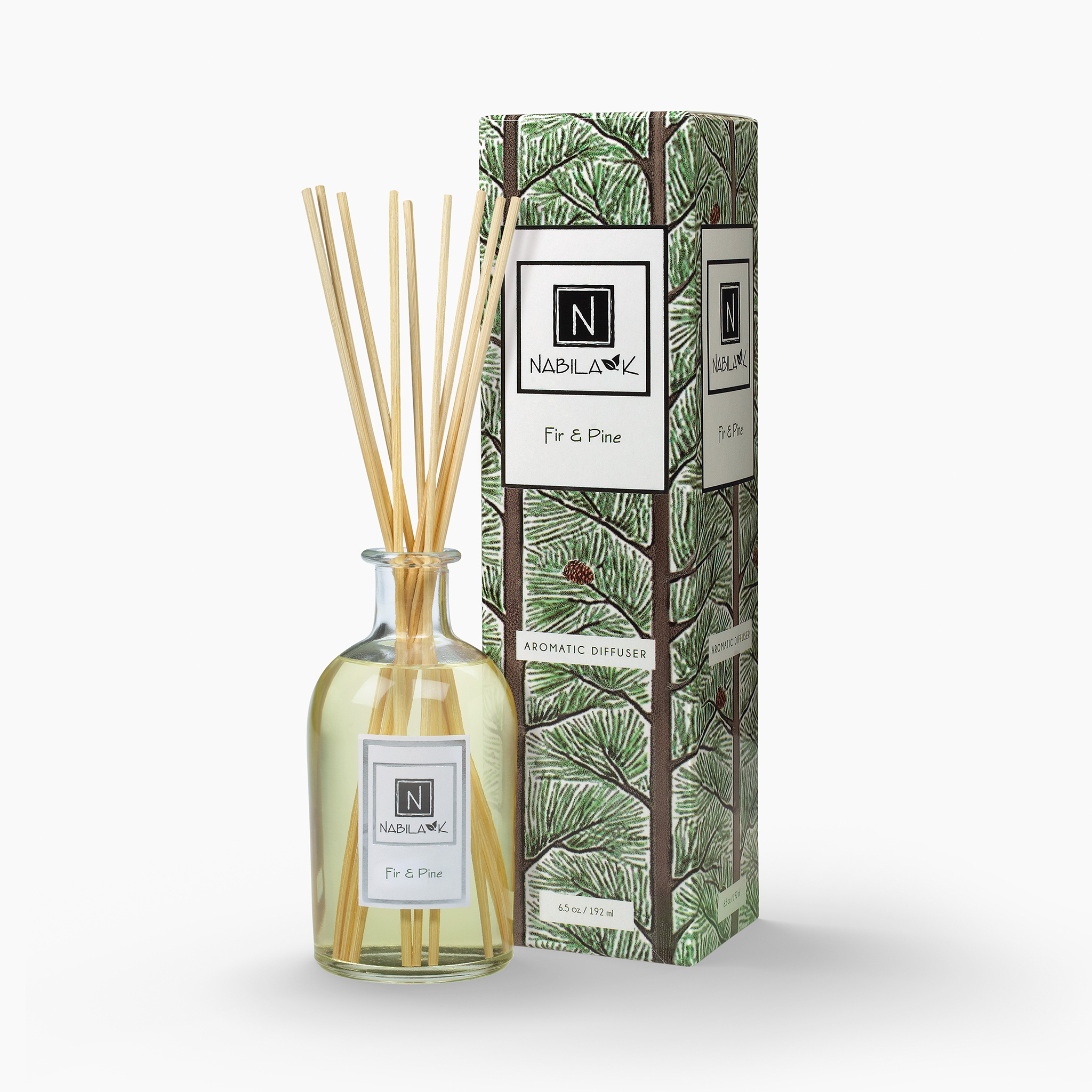 Nabila K's Fir and Pine with reeds inside the bottle with it's packaging next to it