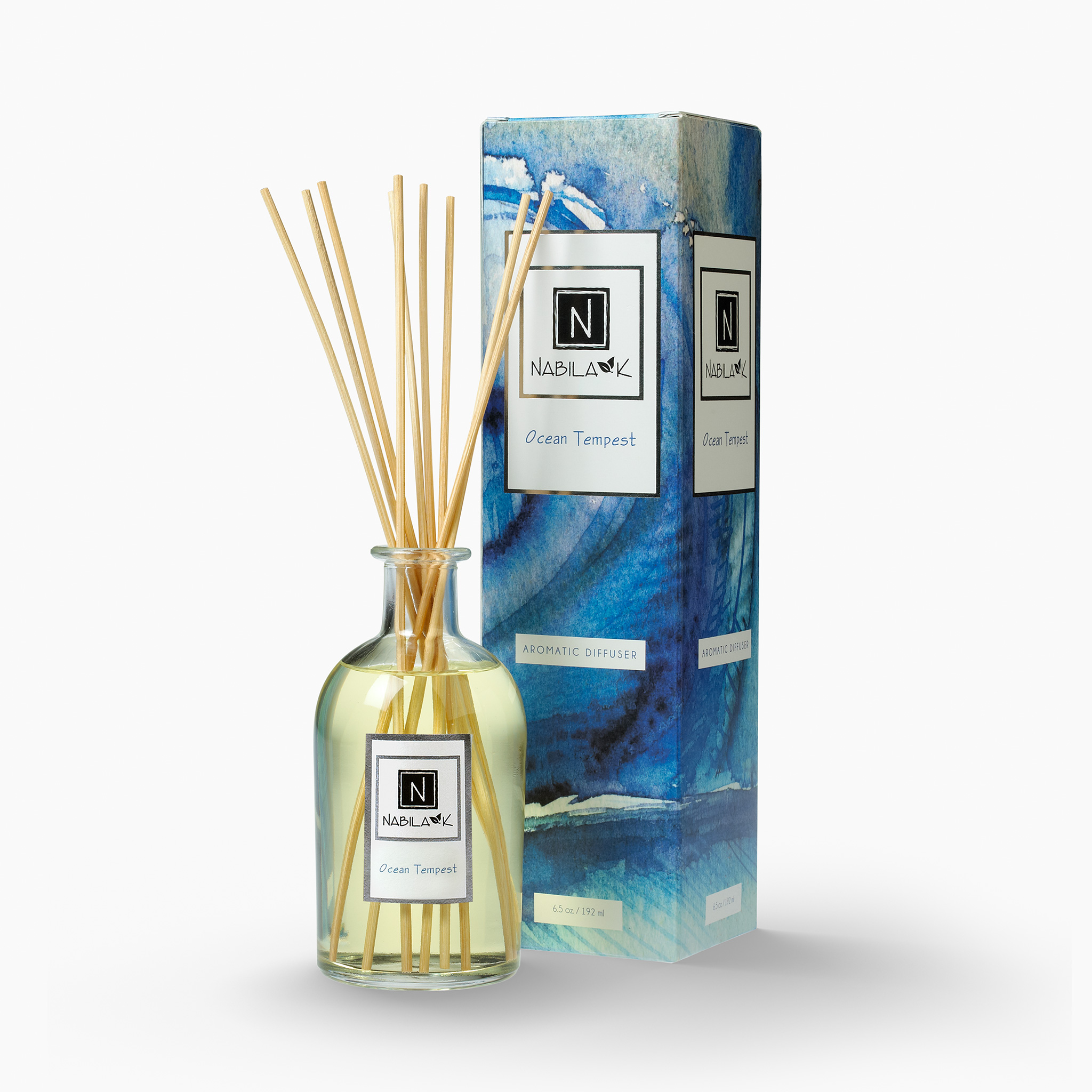 Nabila K's Ocean Tempest with reeds inside the bottle with it's packaging next to it