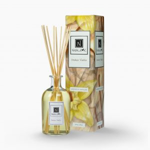 Nabila K's Smokey Vanilla with reeds inside the bottle with it's packaging next to it