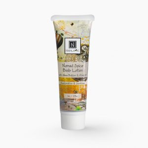 1 oz of Nabila K's Nomad Spice Body Lotion with Shea Butter and Olive Oil Restorative and Soothing in a plastic bottle