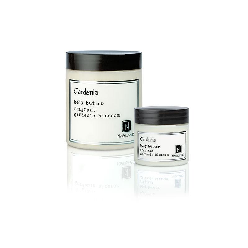 1 2oz and 10oz jar of Nabila K's Gardenia Body Butter with fragrant gardenia blossom