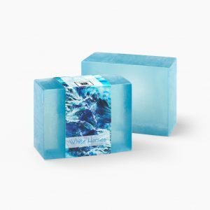 Feel the ocean breezes whisk you away to sea with scents of roses and carnations in this White Horses glycerin soap.