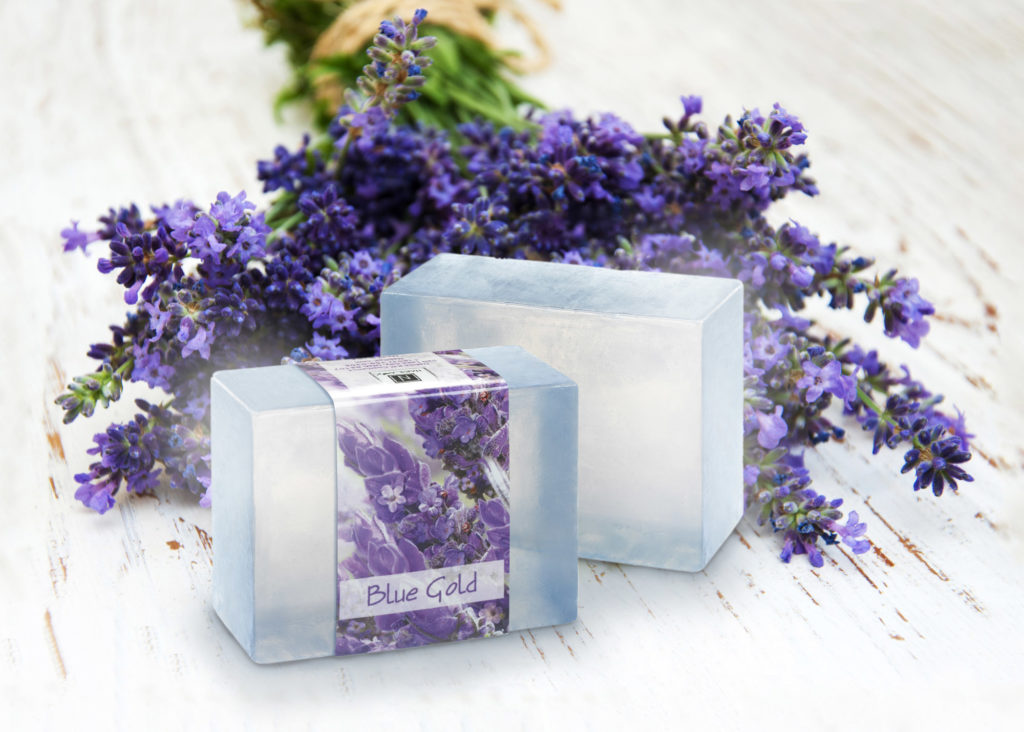 2 Bars of Nabila K's Full Bloom Glycerin Soap in front of Purple Flowers