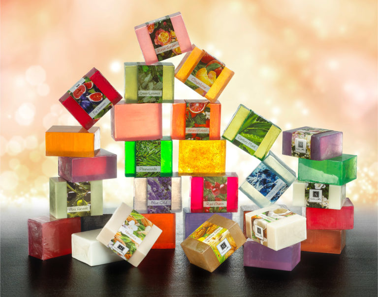 Different Scents of Nabila K's Full Bloom Glycerin Soap Stacked in 6 different piles aesthetically