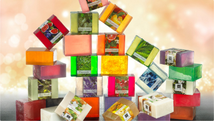 Different Scents of Nabila K's Full Bloom Glycerin Soap Stacked together to form a pyramid