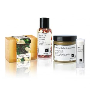 Nabila K's Luxury Kit 2 which includes Revitalizing Organic Kelp Face Polish, ultra-hydrating Argan Oil Hibiscus Rose Face Elixir, Soothing Vanilla Bean Glycerin soap, and naturally healing Acai lip balm