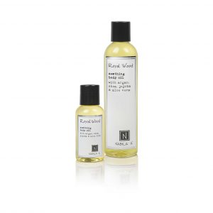 1 Large Size and Travel Size Version of Nabila K's Royal Wood Soothing Body Oil with Argan, Shea, Jojoba, and Aloe Vera